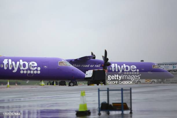 Flybe aircraft are pictured on the tarmac at Exeter airport in Exeter southwest England on March 5 following the news that the airline had collapsed...