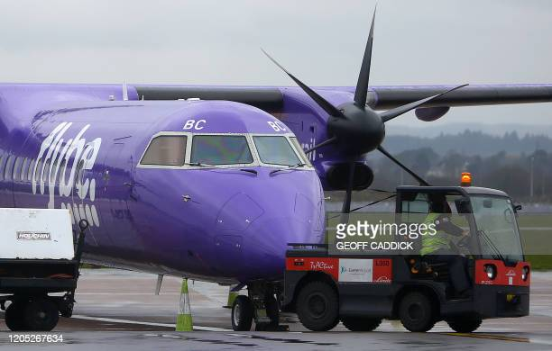 A Flybe aircraft is pictured on the tarmac at Exeter airport in southwest England on March 5 following the news that the airline had collapsed into...