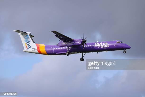 Flybe aircraft landing in Amsterdam Schiphol Airport in The Netherlands The aircraft is a turboprop De Havilland Canada DHC8400 with registration...