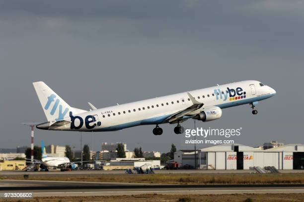 Flybe British European Embraer 195LR taking-off with Air Finland Boeing 757-200 parked behind at Palma International.