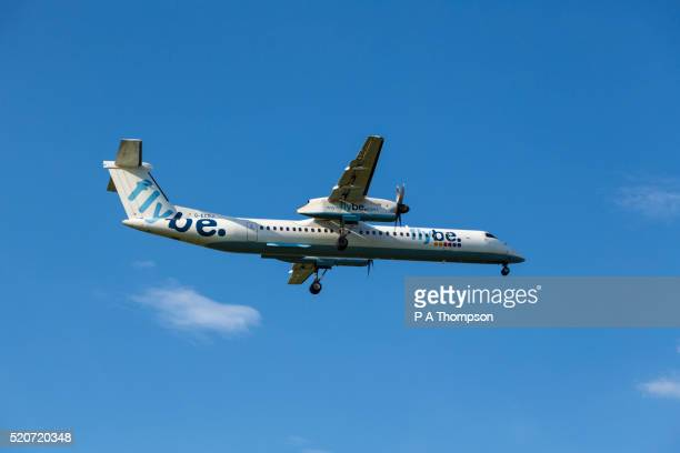flybe de havilland dash 8 coming in to land - flybe stock pictures, royalty-free photos & images