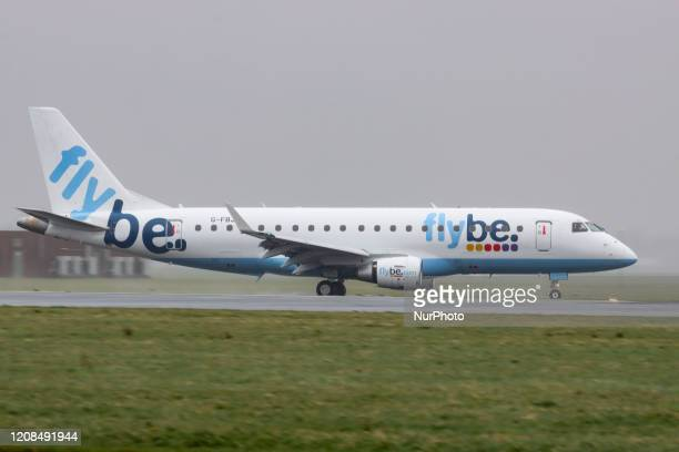 Flybe Embraer ERJ175 aircraft as seen landing and taxiing at Amsterdam Schiphol International Airport The Brazilian made airplane has the...