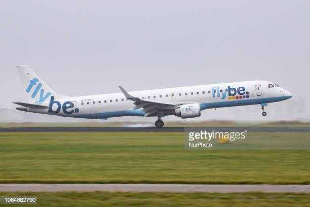 Flybe Embraer ERJ195LR with registration GFBEG is landing at Amsterdam Schiphol International Airport in the mist in The Netherlands Flybe connects...