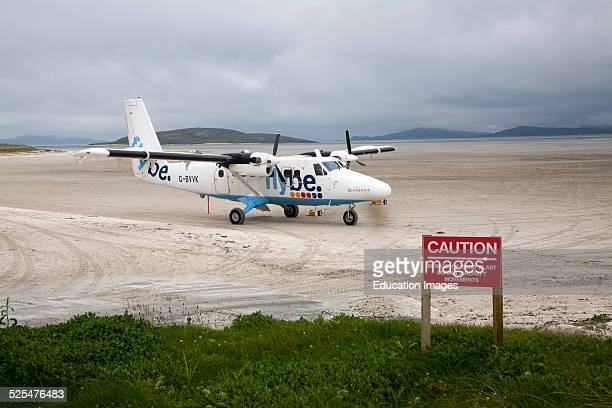 Flybe plane on sandy airstrip Isle of Barra airport Outer Hebrides Scotland