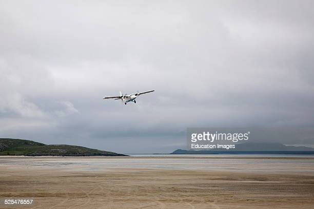 Flybe plane taking off from sandy airstrip Isle of Barra airport Outer Hebrides Scotland