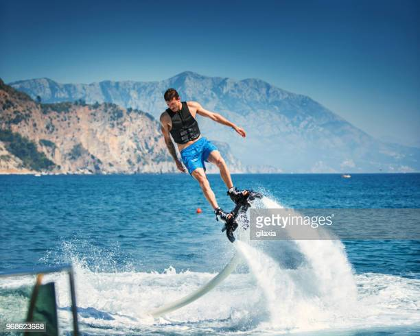 flyboarding. - hoverboard stock pictures, royalty-free photos & images