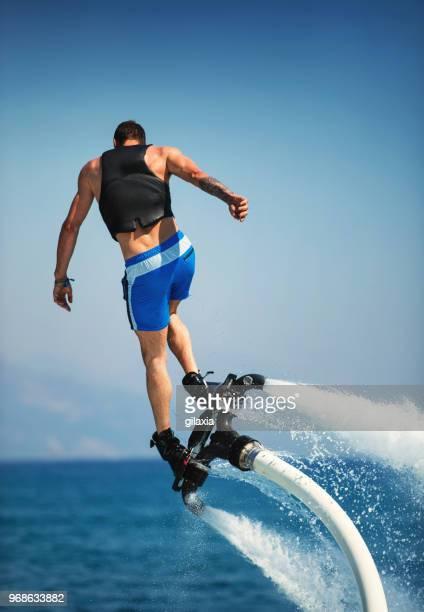 flyboarding. - hoverboard stockfoto's en -beelden