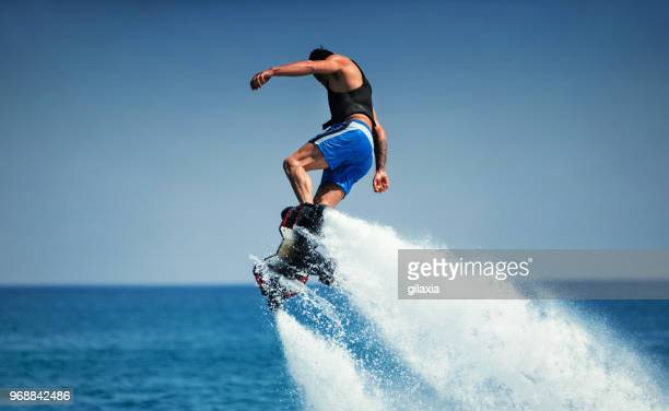 flyboarding. - jet ski stock pictures, royalty-free photos & images
