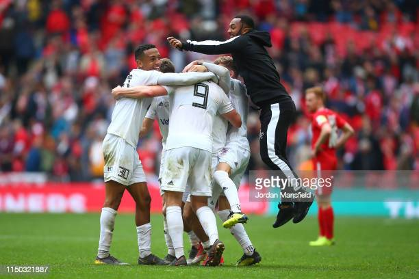 Flyde players celebrate at the end of the FA Trophy Final match between Leyton Orient and AFC Fylde at Wembley Stadium on May 19, 2019 in London,...