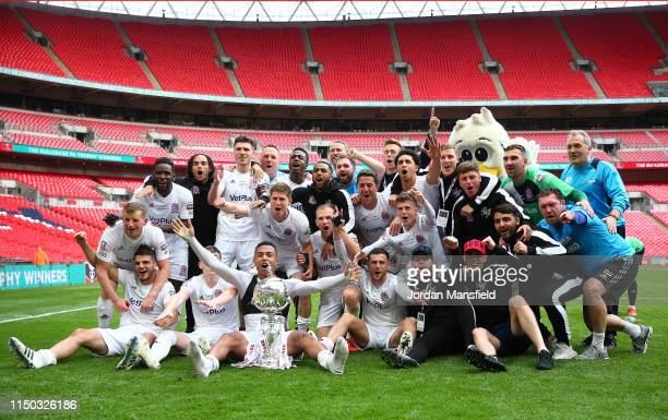Flyde players celebrate with the trophy at the end of the FA Trophy Final match between Leyton Orient and AFC Fylde at Wembley Stadium on May 19,...
