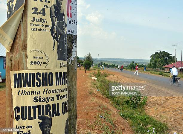 A flyer advertising a concert to celebrate visiting US President Barack Obama's 'homecoming' to the east African nation hangs on an electrical pole...