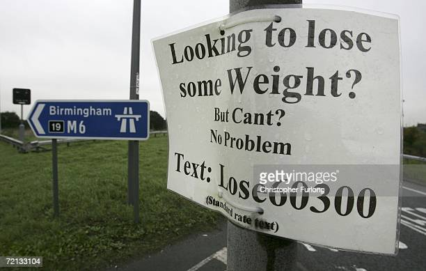 A flyer advertising a weight loss programme is attached to a lamp post to catch the eye of passing motorists at motorway junction on October 10 2006...