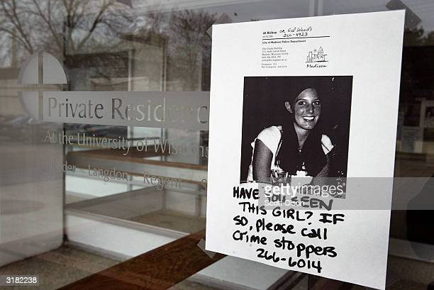 A flyer hangs in the entrance of the apartment building where missing University of Wisconsin student Audrey Seiler lives on March 31 2004 in Madison...