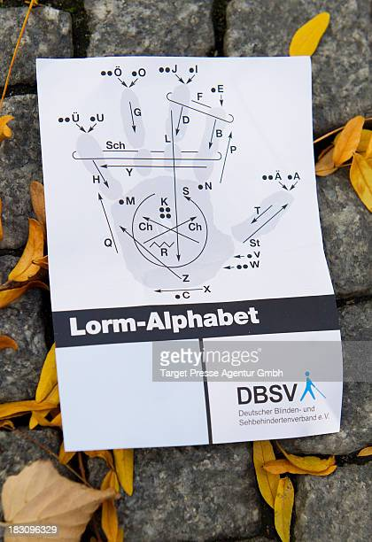 A flyer indicates the Lorm alphabet as hundreds of deaf and blind people demonstrate for more rights on October 4 2013 in Berlin Germany People...