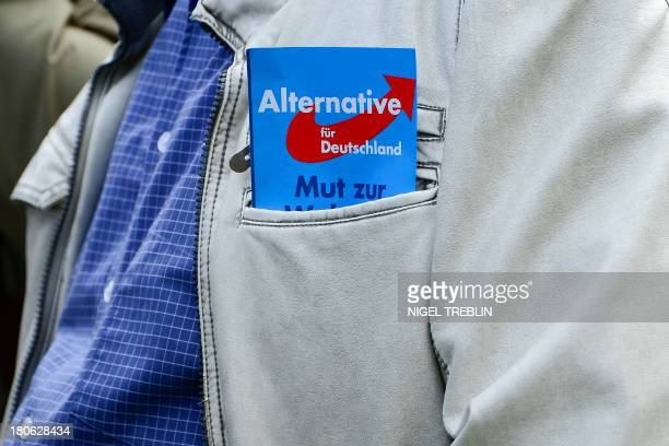 A flyer of Germany's antieuro party Alternative for Germany is seen during an election campaign event on September 15 2013 in Braunschweig central...