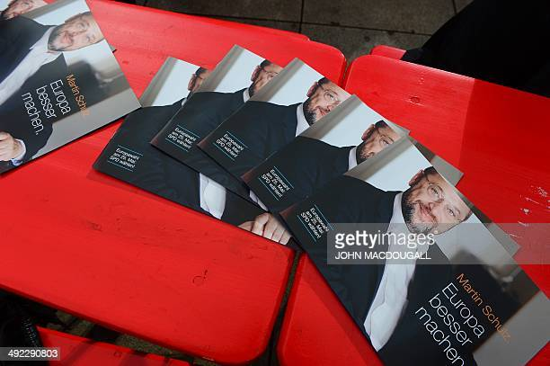 Flyer picturing the top candidate of the German Social Democratic Party for the 2014 European elections Martin Schulz lie on a table ahead of an...