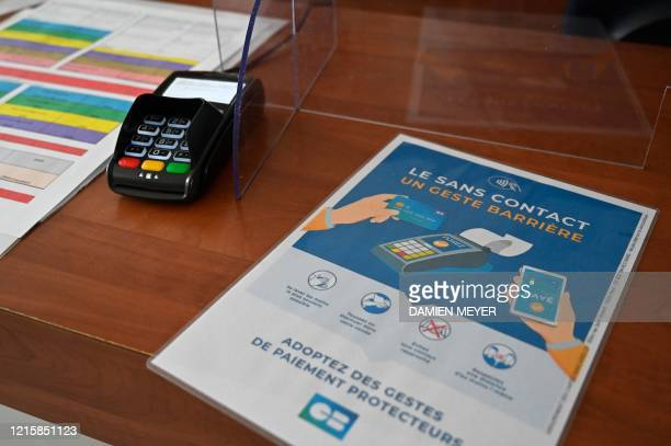 A flyer promotes the contactless payment by credit card at the counter of La conterie public swimming pool in ChartresdeBretagne suburbs of Rennes...