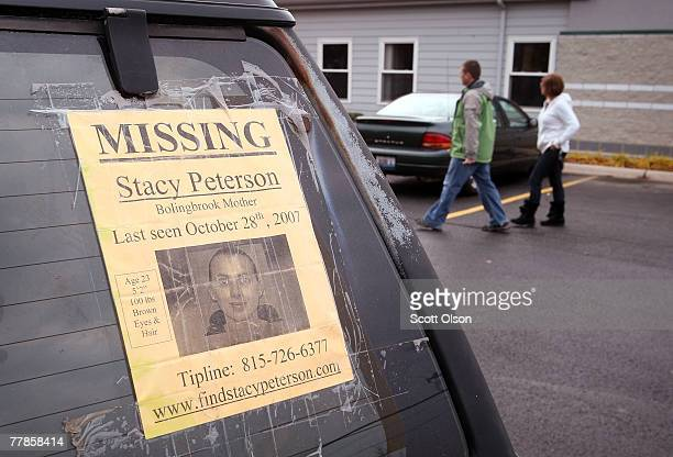 A flyer taped to the window of a car advertises that a search continues for Stacy Peterson the wife of Bolingbrook Illinois police officer Drew...
