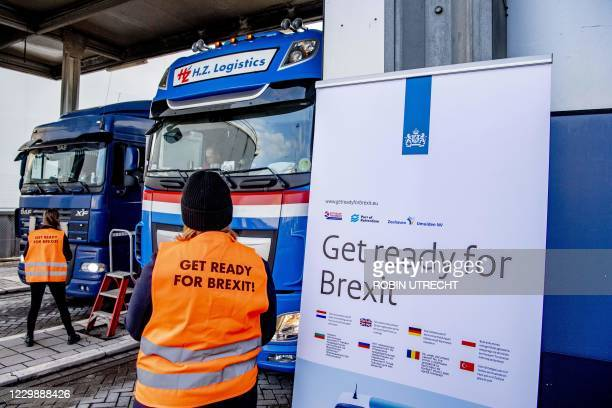 Flyers are distributed, as part of the Get Ready For Brexit campaign, to truck drivers at the terminal of a ferry operator in the port of Rotterdam...