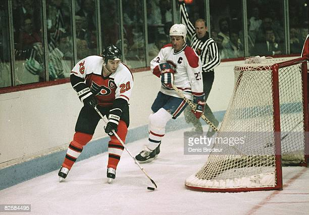 Flyers captain Dave Poulin and Canadiens counterpart Bob Gainey behind the net at the Montreal Forum during the Wales Conference finals in 1987.