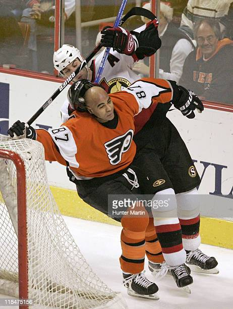 Flyers defenseman Donald Brashear puts a check on Senators defenseman Zdeno Chara during the Ottawa Senators vs Philadelphia Flyers game at Wachovia...