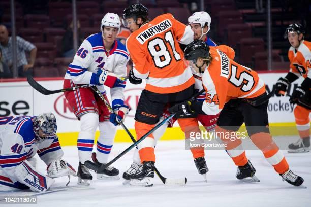 Flyers LW Carsen Twarynski and RW Oskar Lindblom pressure Rangers Goalie Alexandar Georgiev in the first period during the Preseason game between the...
