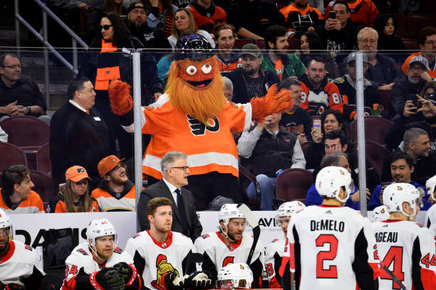 Flyers mascot Gritty entertains fans behind the Ottawa bench in the third period during the game between the Ottawa Senators and Philadelphia Flyers...