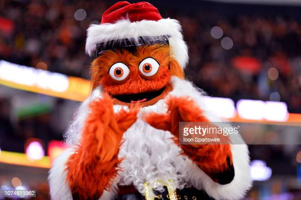Flyers mascot Gritty performs as Santa in the crowd during the game between the Columbus Blue Jackets and Philadelphia Flyers on December 22 2018 at...