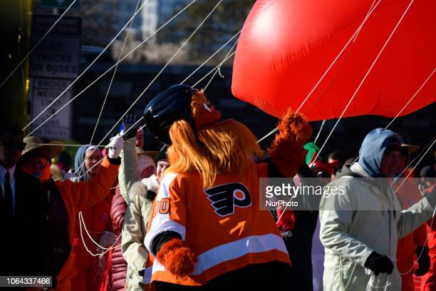 NFL Flyers' mascot Gritty plays with the cord of a balloon during the 99th 6ABC/Dunkin' Donuts Annual Thanksgiving Day parade in Philadelphia PA on...