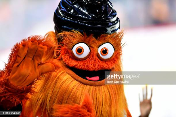Flyers mascot Gritty waves to fans during the game between the Ottawa Senators and Philadelphia Flyers on March 11 2019 at Wells Fargo Center in...
