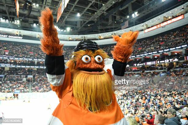 Flyers mascot Gritty waves to the crowd during the regular season game between the Colorado Avalanche and the Philadelphia Flyers on October 22 at...