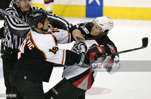 Flyers right winger Branko Radivojevic scuffles with Sabres defenseman Jay McKee during Game 3 of the Eastern Conference Quarterfinals at The...