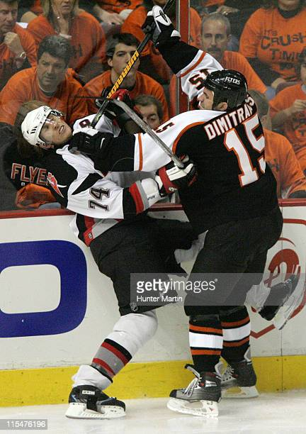 Flyers right winger Niko Dimitrakos checks Sabres defenseman Jay McKee into the boards at The Wachovia Center in Philadelphia Pa Buffalo Sabres at...