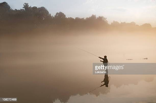 flyfisherman in the fog - wading stock pictures, royalty-free photos & images