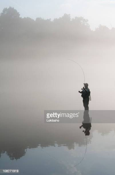 flyfisherman - wading stock pictures, royalty-free photos & images