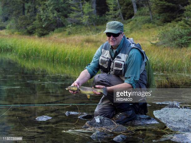 flyfishing at Malghette lake Sole valley Trentino Italy Europe