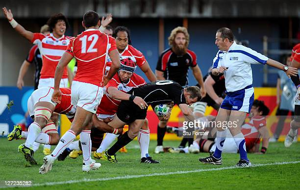 Flyhalf Ander Monro of Canada forces his way over the line to score his team's third try during the IRB 2011 Rugby World Cup Pool A match between...