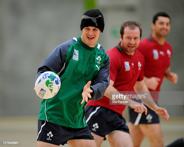 Flyhalf Jonathan Sexton receives the ball as teammates Geordan Murphy and Rob Kearney look on during an Ireland IRB Rugby World Cup 2011 training...