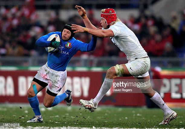Flyhalf Kristopher Burton of Italy is tackled by Mouritz Botha of England during the Six Nations match between Italy and England at Stadio Olimpico...