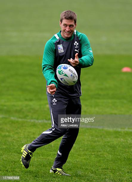 Flyhalf Ronan O'Gara passes the ball during an Ireland IRB Rugby World Cup 2011 training session at Rugby League Park on October 5 2011 in Wellington...