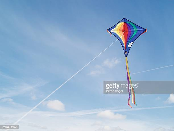 flying a kite - kite toy stock pictures, royalty-free photos & images