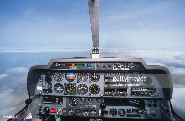 flying above a layer of low clouds with an early GPS unit at bottom right side of the panel in the cockpit of a Robin DR400180 Regent