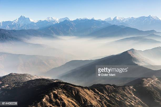 flying above the clouds in the himalayas in nepal - nepal stock pictures, royalty-free photos & images