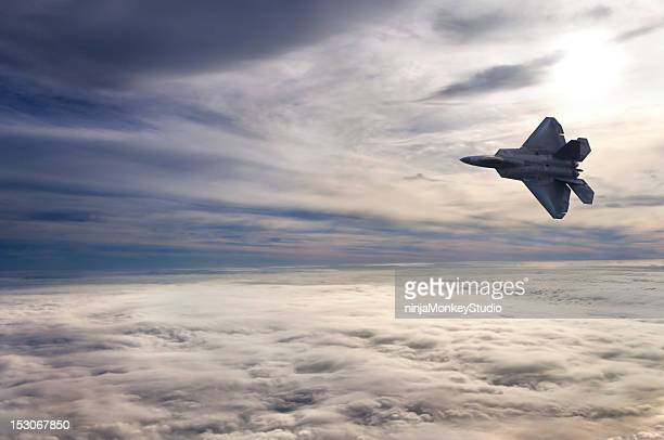 F22 Flying Above the Clouds