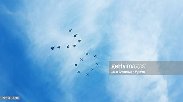 Flying Airplanes Forming Number 70 In Cloudy Sky