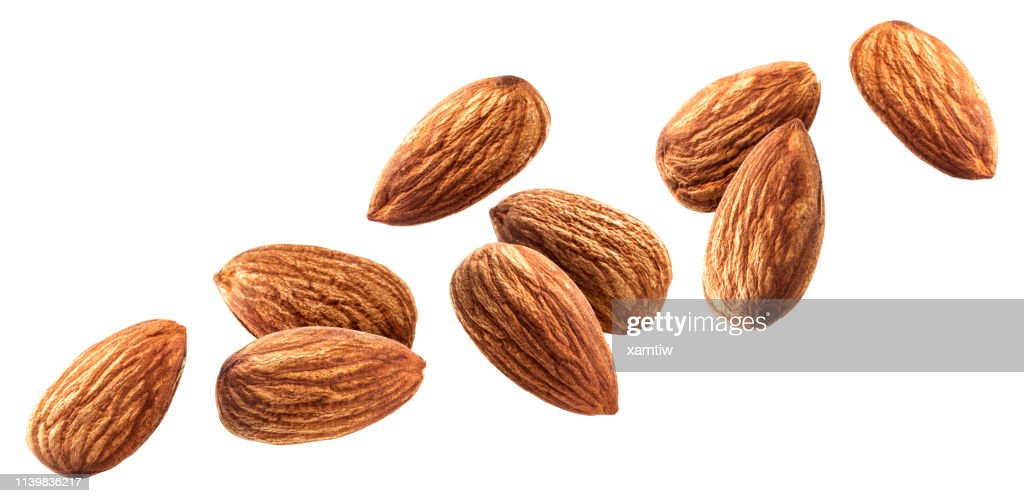 Flying almond isolated on white background with clipping path : Stock Photo