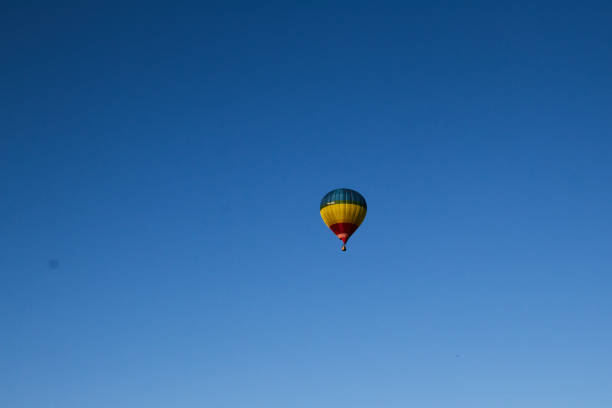 A flying balloon in a bright blue sky. Blue. Beautiful blue.