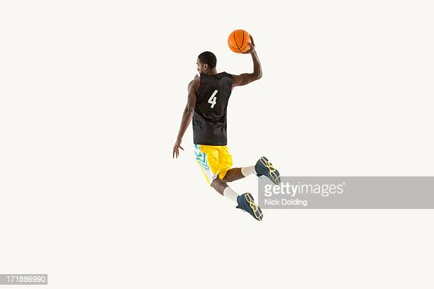 flying basketball player 05 - shooting baskets stock pictures, royalty-free photos & images