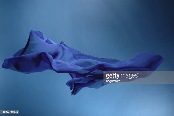 flying blue silk - silk stock pictures, royalty-free photos & images