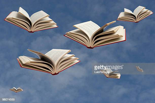 flying books - flying stock pictures, royalty-free photos & images